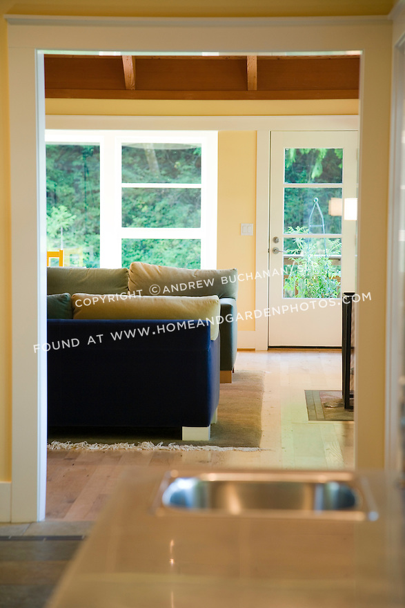 long view from the kitchen through center hall to the living room (LR) of a waterfront weekend vacation retreat on Washington State's Vashon Island