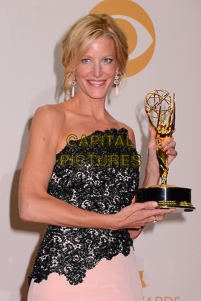 Anna Gunn<br /> 65th Annual Primetime Emmy Awards - Press Room held at Nokia Theatre L.A. Live, Los Angeles, California, USA.<br /> September 22nd, 2013<br /> award trophy winner half length dress black lace pink strapless  <br /> CAP/ADM/BT<br /> &copy;Birdie Thompson/AdMedia/Capital Pictures