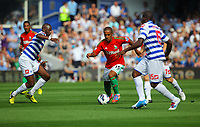 FAO SPORTS PICTURE DESK<br /> Pictured: Wayne Routledge of Swansea (2nd L) is closely watched by L-R Samba Diakite Nedum Onuoha and Ji-Sung Park of QPR. Saturday 18 August 2012<br /> Re: Barclay's Premier League, Queens Park Rangers v Swansea City FC at Loftus Road Stadium, London, UK.