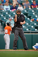 Umpire John Mang calls a strike during an International League game between the Norfolk Tides and Buffalo Bisons on June 21, 2019 at Sahlen Field in Buffalo, New York.  Buffalo defeated Norfolk 2-1, the first game of a doubleheader.  (Mike Janes/Four Seam Images)