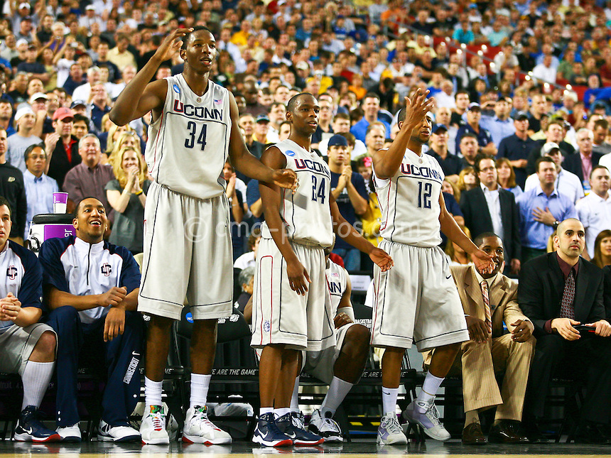 Mar 26, 2009; Glendale, AZ, USA; Connecticut Huskies center Hasheem Thabeet (34), guard Craig Austrie (24), and guard A.J. Price (12) react to a teammates mistake late in the second half of a game against the Purdue Boilermakers during the semifinals of the west region of the 2009 NCAA basketball tournament at University of Phoenix Stadium.
