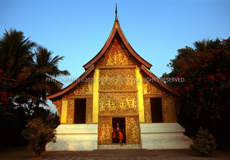 5/1/2003--Luang Prabang, Laos..Wat Xieng Thong on the northern tip of Luang Prabang. It was built by King Saisetthathirat in 1560 and is located on a peninsula, in between the Mekong and Khan rivers...All photographs ©2003 Stuart Isett.All rights reserved.This image may not be reproduced without expressed written permission from Stuart Isett.