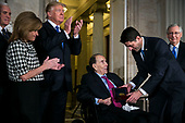 Former Senator Bob Dole is presented with the congressional Gold Medal, by U.S. House Speaker Paul Ryan, a Republican from Wisconsin, at the U.S. Capitol, in Washington D.C., U.S., on Wednesday, Jan. 17, 2018. From left: U.S. Vice President Mike Pence, Congresswoman Lynn Jenkins, a Republican from Kansas, U.S. President Donald Trump, Dole, Ryan, and Senate Majority Leader Mitch McConnell, a Republican from Kentucky. Photographer: Al Drago/Bloomberg<br /> Credit: Al Drago / Pool via CNP