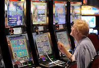 Marie Nelson sits and plays the slot machines at the Grand opening of the Sands Casino Resort Bethlehem Tuesday, June 9, 2009, in Bethlehem, PA. The slots casino occupies the former Bethlehem Steel Corporation's mill complex. (AP Photo/Bradley C Bower)
