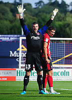Fleetwood Town's Matt Gilks, left, and Lincoln City's Tyler Walker<br /> <br /> Photographer Chris Vaughan/CameraSport<br /> <br /> The EFL Sky Bet League One - Lincoln City v Fleetwood Town - Saturday 31st August 2019 - Sincil Bank - Lincoln<br /> <br /> World Copyright © 2019 CameraSport. All rights reserved. 43 Linden Ave. Countesthorpe. Leicester. England. LE8 5PG - Tel: +44 (0) 116 277 4147 - admin@camerasport.com - www.camerasport.com