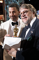 Host, Jimmy Kimmel poses with Guillermo del Toro, Oscar&reg;  winner for best motion picture of the year for work on &ldquo;The Shape of Water&rdquo; during the live ABC Telecast of The 90th Oscars&reg; at the Dolby&reg; Theatre in Hollywood, CA on Sunday, March 4, 2018.<br /> *Editorial Use Only*<br /> CAP/PLF/AMPAS<br /> Supplied by Capital Pictures