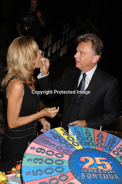 "Vanna White and Pat Sajak cutting the cake..at The 25th Anniversary party for ""Wheel of Fortune"" ..on September 27, 2007 at Radio City Music Hall, where they will tape 3  weeks of shows.....photo by Robin Platzer, Twin Images....212-935-0770"