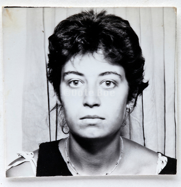 photo booth style head and shoulder ID image of a young adult woman 1980s