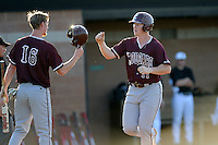 Second baseman Blake Butler (16), left, of the College of Charleston Cougars, congratulates teammate Nick Pappas (11) after each scored a run in the third inning of a game against the University of South Carolina Upstate Spartans on Tuesday, March 31, 2015, at Cleveland S. Harley Park in Spartanburg, South Carolina. Charleston won, 10-0. (Tom Priddy/Four Seam Images)