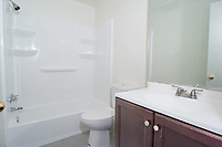 Condo with brand new bathroom by Art Harman. Don't settle for dim and dingy cell phone photos to sell or rent your property.