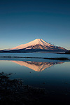 Mt. Fuji is the highest mountain in Japan, and its symmetrical cone is a frequently used symbol in Japanese art.