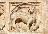 Medieval relief sculptures of mythical lion on the exterior of the Romanesque Baptistery of Parma, circa 1196, (Battistero di Parma), Italy
