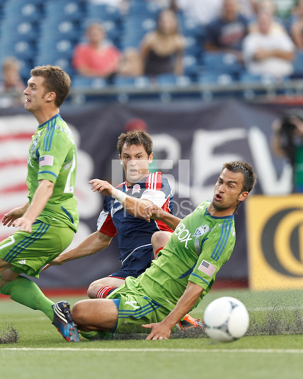 New England Revolution forward Blake Brettschneider (23) drive squirts free for an assist on a goal. In a Major League Soccer (MLS) match, the New England Revolution tied the Seattle Sounders FC, 2-2, at Gillette Stadium on June 30, 2012.