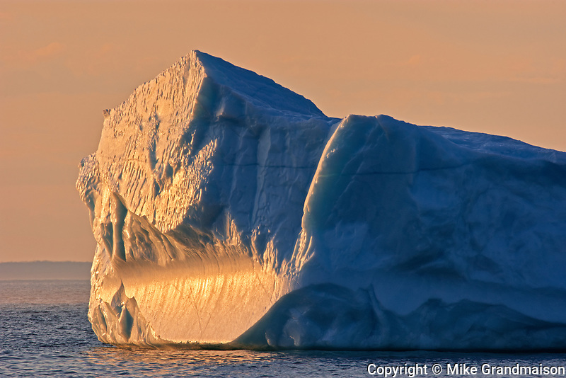 Iceberg at sunset  in La Scie Harbour off the Atlantic Ocean. Baie Verte Peninsula.<br />