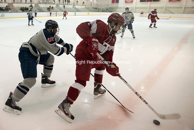 WATERTOWN,  CT-020415JS04- Taft's Will Bailey (2) tries to get away from Kent's Keanu Hilaire(5) during their game Wednesday at Oden Rink on the Taft campus in Watertown. <br /> Jim Shannon Republican-American