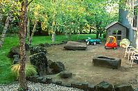 Shady backyard garden with children's play area, design Jeff Allen