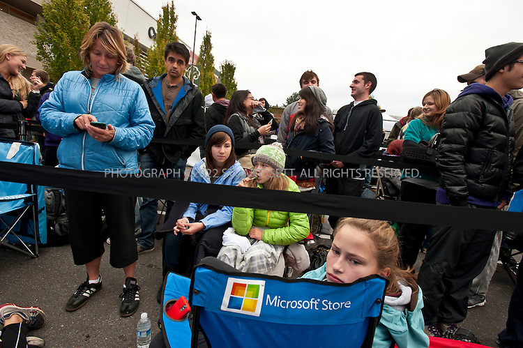 10/20/2011--Seattle, WA, USA..13 year old Mary Luken-Raz waited overnight for the opening of the new Microsoft store in Seattle WA...Microsoft (MSFT) opened their 12th retail store in Seattle's U-Village shopping center today. Nearly 1000 people waited in line for the opening of the company's first store in Seattle. The store opened up directly across from an Apple store. Nationwide, Microsoft will open two more this fall, in California and Virginia. ..©2011 Stuart Isett. All rights reserved.