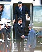 Camp David, MD - October 18, 2008 --  United States President George W. Bush, right, welcomes President Nicolas Sarkozy of France, who also serves as this year's rotating President of the European Union (EU), left, and President José Manuel Barroso of the European Commission (EC), top, to the Presidential Retreat near Thurmont, Maryland for talks on Saturday, October 18, 2008.  The two European leaders stopped at Camp David to meet with President Bush to discuss the economy on their way home from a summit in Canada to try to convince Bush to support a summit by year's end to try to reform the world financial system..Credit: Ron Sachs / Pool via CNP
