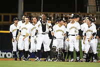 Bradenton Marauders outfielder Raul Fortunato (35 - shirt open) walks off the field after being mobbed by teammates including Max Moroff (31), Jhondaniel Medina (34), Jin-De Jhang (47), Eric Wood (48) after the game winning hit during a game against the Palm Beach Cardinals on April 8, 2014 at McKechnie Field in Bradenton, Florida.  Bradenton defeated Palm Beach 4-3.  (Mike Janes/Four Seam Images)