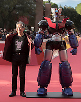 Il fumettista e scrittore giapponese Go Nagai posa sul red carpet per la presentazione del film &quot;Mazinga Z Infinity&quot; alla Festa del Cinema di Roma , 27 0ttobre 2017.<br /> Japanese cartoonist and writer and Go Nagai  poses on the red carpet to present the movie &quot;Mazinga Z Infinity&quot; during the international Rome Film Festival at Rome's Auditorium, October 27, 2017.<br /> UPDATE IMAGES PRESS