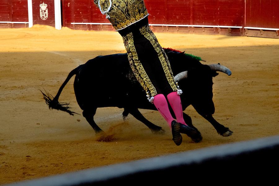 A Spanish bullfighter (matador) performs at the bullring in Torremolinos, Spain, 28 July 2006.