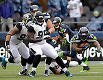 Seattle Seahawks running back Marshawn Lynch (24) dives for extra yardage after being tripped up by Jacksonville Jaguars  linebacker Jason Babin (58) during the first quarter at CenturyLink Field in Seattle, Washington on September 22, 2013. The Seahawks beat the Jaguars 45-17. ©2013. Jim Bryant Photo. ALL RIGHTS RESERVED.