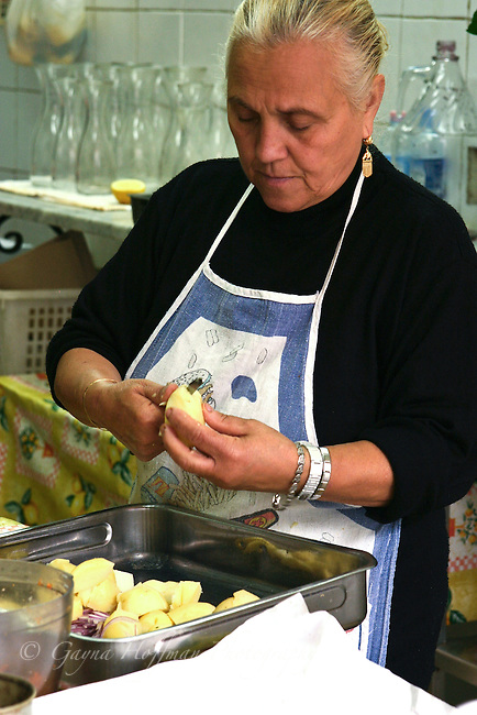 Woman peeling potatoes. Palermo, Sicily
