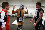 Lucha Libre AAA wrestlers, from left, Jack Evans, Silver King, and Vampiro go over their routine backstage before a match in San Jose, CA March 29, 2009.