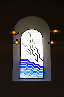 Jelling Kirke (Gudstjeneste) modern stained glass window in famous church, birthplace of Christianity in Denmark