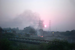 Sun rising on the outskirts of New Delhi, India.