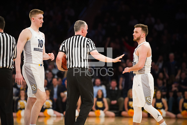 NEW YORK, NY - Thursday March 9, 2017: Andrew Rowsey (#30) of Marquette is calmed down after a brief scuffle with Seton Hall as the two schools square off in the Quarterfinals of the Big East Tournament at Madison Square Garden.
