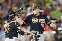 Oregon State pitcher Matt Boyd (31) celebrates with catcher Jake Rodriguez (13)immediately following Game 9 of the 2013 Men's College World Series against the Indiana Hoosiers on June 19, 2013 at TD Ameritrade Park in Omaha, Nebraska. The Beavers defeated the Hoosiers 1-0, eliminating Indiana from the tournament. (Andrew Woolley/Four Seam Images)