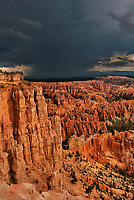 730750175v tourists watch a summer lightning storm pass over the silent city and bryce canyon from bryce point bryce canyon national park utah united states
