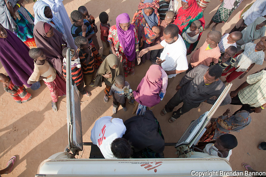 MSF ambulance arriving to pick up patients identified by community health survelience teams at the reception center. MSf screens and immunizes childen and families at the first point of interaction for recently arrived refugees from Somalia.