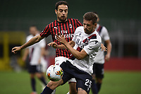Giacomo Bonaventura of AC Milan and Gabriele Corbo of Bologna FC compete for the ball during the Serie A football match between AC Milan and Bologna FC at stadio Giuseppe Meazza in Milano ( Italy ), July 18th, 2020. Play resumes behind closed doors following the outbreak of the coronavirus disease. <br /> Photo Image Sport / Insidefoto