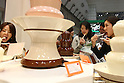 Apr. 8, 2010 - Tokyo, Japan - Visitors taste chocolate at a stall during the Dessert Sweet & Drink Festival 2010 at Tokyo Big Sight, on April 8, 2010. Organized by the Japan Food Journal and the All Japan Confectionery Association, the event will run April 8-9 and 65,000 trade professionals are expected to attend.
