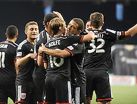 Washington D.C. - July 30, 2014:  Chris Rolfe (18) of D.C. United celebrates his score with teammates. D.C. United defeated the Toronto FC 3-1 during a Major League Soccer match for the 2014 season at RFK Stadium.