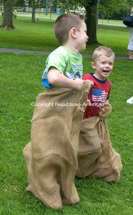 LITCHFIELD, CT - 04 JULY 2008 -070408JW12.jpg -- While visiting from Maryland Jimmy Dlugokinski age 6 and Ryan Dlugokinski age 4 compete in a sack race Friday afternoon on the Litchfield Green during the Litchfield Historical Society for a Turn of the Century Fest and Fourth of July Pet Parade. Jonathan Wilcox Republican-American
