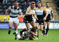 PICTURE BY VAUGHN RIDLEY/SWPIX.COM - Rugby League - Super League - Hull FC v Wigan Warriors - KC Stadium, Hull, England - 22/04/12 - Wigan's Josh Charnley is tackled by Hull's Jamie Ellis.