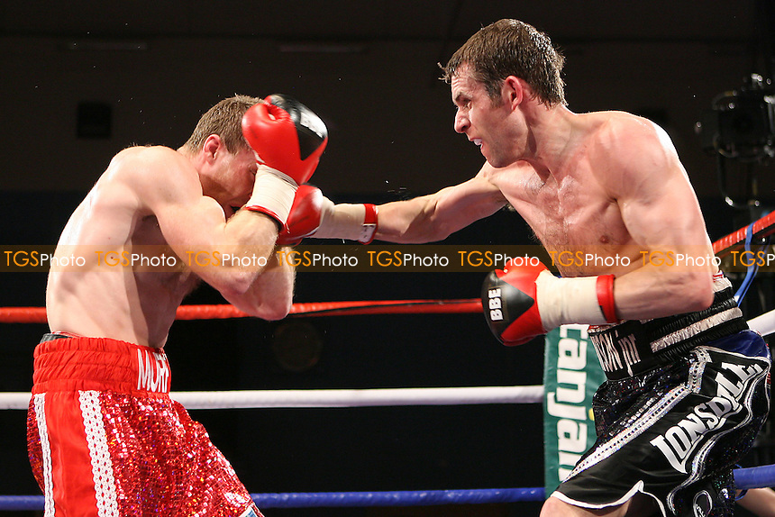 John Watson (black shorts) defeats Ben Murphy in a Lightweight boxing contest at the Indoor Sports Centre, Leigh, promoted by Frank Maloney - 19/03/10 - MANDATORY CREDIT: Chris Royle/TGSPHOTO - Self billing applies where appropriate - Tel: 0845 094 6026.