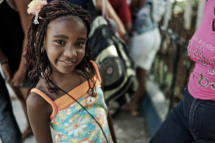 Images from the old Havana, Cuba, Latin America. ..Girl waiting in line of Coppelia, the ice cream place for the locals where they can pay in local currency.