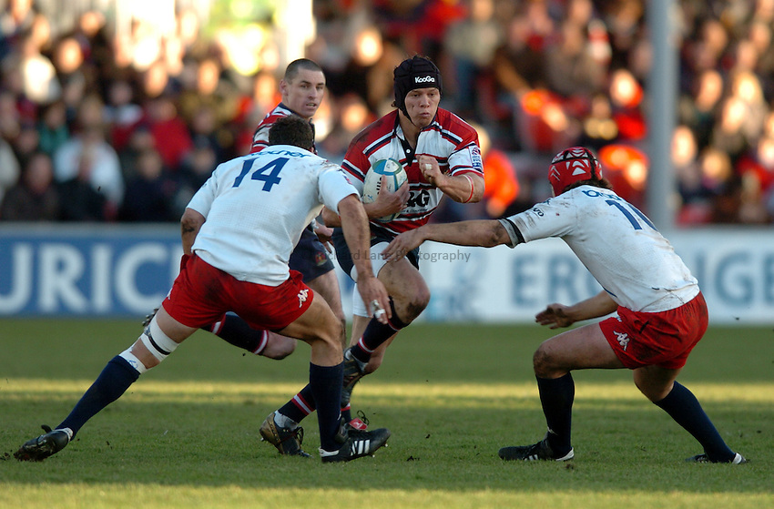 Photo. Henry Browne..Gloucester v Stade Francais. Heineken Cup Pool Six. 16/01/2005..Henry Paul runs into a tackle..