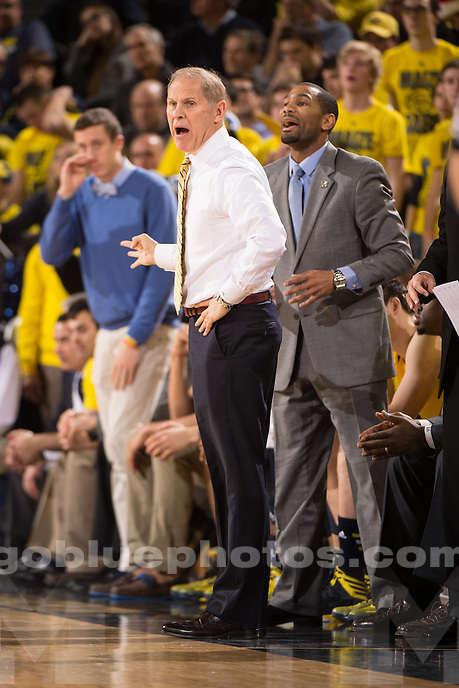 The University of Michigan men's basketball team defeats Syracuse, 68-65, at Crisler Arena in Ann Arbor on Dec. 2, 2014.