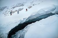 Ski touring above a glacier crevasse in a whiteout during the Öztal ski tour, Austria