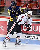 Tom McCarthy (Merrimack - 6), Garrett Vermeersch (NU - 9) - The Northeastern University Huskies defeated the visiting Merrimack College Warriors 4-2 (EN) on Wednesday, October 10, 2012, at Matthews Arena in Boston, Massachusetts.