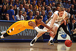 SIOUX FALLS, SD - MARCH 12:  Kory Brown #22 from North Dakota State University dives for a loose ball with Nate Wolters #3 from South Dakota State University in the second half of the 2013 Summit League Championship Game Tuesday evening at the Arena in Sioux Falls, SD.  (Photo by Dave Eggen/Inertia)