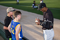 Joel Booker (23) of the Kannapolis Intimidators autographs a baseball for a fan prior to the game against the Hickory Crawdads at Kannapolis Intimidators Stadium on May 18, 2017 in Kannapolis, North Carolina.  The Crawdads defeated the Intimidators 6-4.  (Brian Westerholt/Four Seam Images)