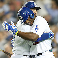 September 24, 2014 Los Angeles, CA: Los Angeles Dodgers first baseman Adrian Gonzalez #23 and right fielder Yasiel Puig #66 during an MLB game between the San Francisco Giants and the Los Angeles Dodgers played at Dodger Stadium The Dodgers defeated the Giants 9-1 to win the National League West Title.