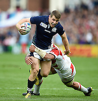 Mark Bennett of Scotland is tackled in possession. Rugby World Cup Pool B match between Scotland and Japan on September 23, 2015 at Kingsholm Stadium in Gloucester, England. Photo by: Patrick Khachfe / Onside Images
