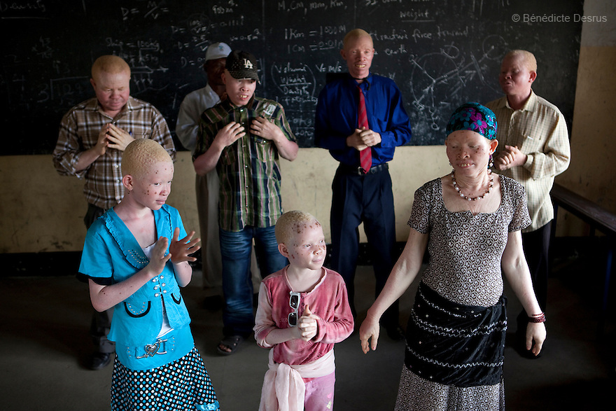 June 15, 2010 - Dar Es Salaam, Tanzania - Albinos and relatives performs during a theater practice in preparation for an upcoming show organized by the Tanzania Albino Society Kinondoni District  in order to spread awarness on albinos issues in Tanzania. Tanzania is believed to have Africa' s largest population of albinos, a genetic condition caused by a lack of melanin in the skin, eyes and hair and has an incidence seven times higher than elsewhere in the world. Over the last three years people with albinism have been threatened by an alarming increase in the criminal trade of Albino body parts. At least 53 albinos have been killed since 2007, some as young as six months old. Many more have been attacked with machetes and their limbs stolen while they are still alive. Witch doctors tell their clients that the body parts will bring them luck in love, life and business. The belief that albino body parts have magical powers has driven thousands of Africa's albinos into hiding, fearful of losing their lives and limbs to unscrupulous dealers who can make up to US$75,000 selling a complete dismembered set. The killings have now spread to neighboring countries, like Kenya, Uganda and Burundi and an international market for albino body parts has been rumored to reach as far as West Africa. Photo credit: Benedicte Desrus